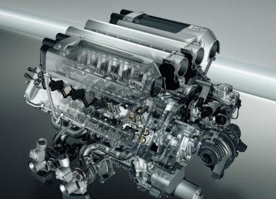 Découvrez le fabuleux moteur de 1001 ch de la Bugatti Veyron 16.4. 16 cylindres sur 4 rangées (d'où le nom de l'auto pour 4 turbos. Du jamais vu sur une voiture de série.
